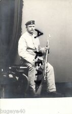 German soldier wearing fatigue dress and holding rifle Hannover photo