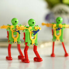 1PC Wind Up Dance Robot Plastic Clockwork Spring Yellow Green Red Baby Toy Gift
