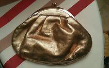 Trousse a maquillage ou porte monnaie  jean Paul gaultier  doré  rose classique