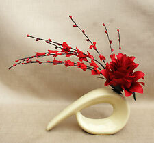 ARTIFICIAL RED DRAGON FLOWER WITH RED FLOWERS IN CREAM COMMA SHAPE CERAMIC VASE