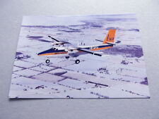 Postcard (DT37) - Brymon DHC6 Twin Otter in flight over snow - G-BFGP
