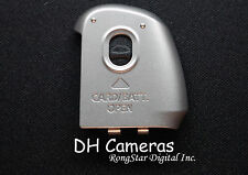 CANON POWERSHOT SX150 IS BATTERY DOOR Cover NEW AUTHENTIC Silver A1145