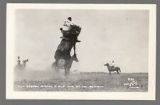 [60032] OLD REAL PHOTO POSTCARD DICK RABURN RIDING A WILD ONE AT THE ROUNDUP