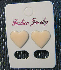 Very pretty earrings with pink heart studs