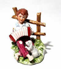 Vintage Porcelain Boy Playing Accordion  in Grass with Puppy Dog