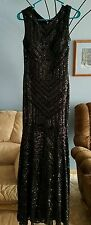 Black sparkly prom dress size large. Fits like an 8. Tight but bottom flares