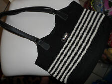 Ladies black and tan crochet handbag by Frankie and Johnnie