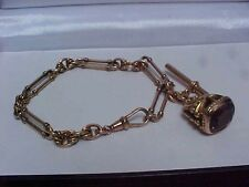 ANTIQUE ROLLED ROSE GOLD WATCH CHAIN,TROMBONE LINKS & LARGE ORNATE GEM SET FOB