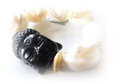 Per trendsetter: nei mari del sud CONCHIGLIA-braccialetto con Buddha-testa in nero (b1)