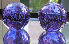 Paperweight : a good sized pair (2X) weights in amethyst glass having bubbles