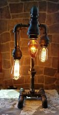 Handcrafted Industrial Pipe Three Tier steampunk style lamp with edison bulbs.