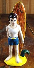 YOUNG BOY WHITE TANK TOP BLUE SHORTS ORANGE SURF BOARD CAST IRON BOTTLE OPENER