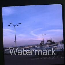 1960s  amateur Kodachrome Photo slide young cars automobiles in parking lot