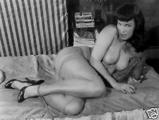Bettie Page lying propped up on pillows in sheer dress  5 x 7  Photograph