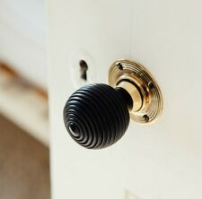 Solid Ebony Beehive Door Knobs (Pair) - Aged Brass Collar & Rose