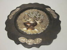 VINTAGE HAND HAMMERED METAL MIDDLE EASTERN BOY CARRYING LILIES DESIGN BY FLATY