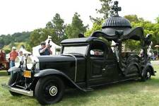 Old Photo. Black 1929 Buick Hearse at Auto Show