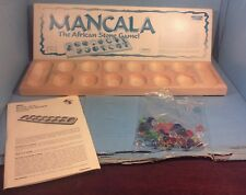 Wood mancala game board with beads and instructions~World Wide Games