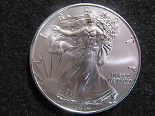 2014 AMERICAN SILVER EAGLE, 1 OZ FINE SILVER STUNNING LUSTER AND EYE APPEAL