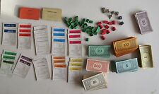 Vintage Monopoly game tokens money wooden houses hotels deeds spares  .