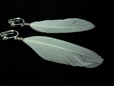 A PAIR OF LONG WHITE FEATHER  DANGLY CLIP ON EARRINGS.