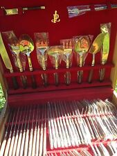 Boxed brass cutlery,gold 12 person setting massive set, like new value $1500
