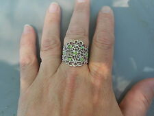 Paparazzi StretchBand Ring (new) WITH A TWIST (SILVER W/SM GREEN STONES)