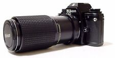 Nikon EM 35mm Film Camera + Tokina 80-200 mm F/4.5 Constant Lens | Works Well.