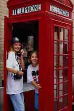 673030 Young Girls At Old Style Telephone Booth London England A4 Photo Print