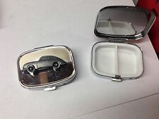Porsche 356A ref183 pewter effect car emblem on a silver metal pill box