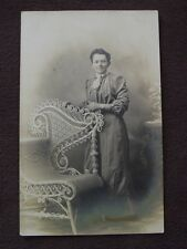 PETITE OLDER WOMAN STANDING NEXT TO FANCY WICKER CHAIR VTG  REAL PHOTO POSTCARD