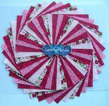 Quilting Fabric, Cranberry Red Swirl Charm pack 5 inch squares 40 per pk.