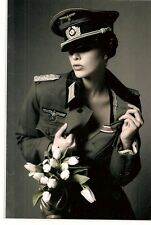 PORTRAIT German girl in a military uniform sexy . nude