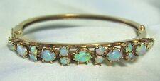 """14K Gold & Opal Hinged Bangle Bracelet 16.7 grams 17 opals 1/4"""" wide"""