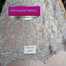 Wonderful Bridal luxury wedding beaded white mesh lace fabric. Sold by the yard