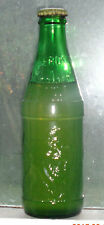 old lion embossed clear Simba soda bottle full with Coca Cola mark on cap