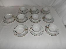 Service de 10 tasses à café en porcelaine de Limoges A T décor fleur filet doré