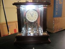 WALLACE MAHOGANY CARRIAGE CLOCK WITH SPINNING CROWN