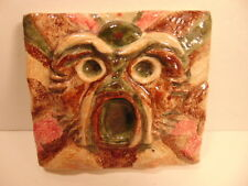 Signed  decorative ceramic tile with roaring or fierce animal face