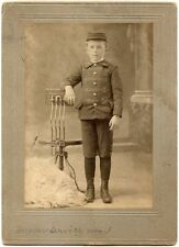 YOUNG BOY IN UNIFORM WITH POSING STOOL VINTAGE PRINT