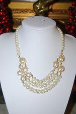 RSVP TAGGED STATEMENT NECKLACE OF FAUX GLASS PEARLS AND GOLD TONED METAL ACCENTS