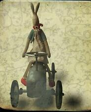 Old Photo. Antique Toy Rabbit on Toy Car