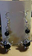 Orecchini donna teiera colore argento con perla nera...prodotti senza nichel....