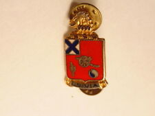 Military insignia pin showing a canon, cactus, and legend In Via