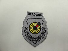 MILITARY PATCH COLORED SEW ON OLDER VINTAGE US AIR FORCE GRADUATE FIGHTER WEAPON