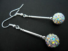 A PAIR OF DANGLY WHITE SHAMBALLA STYLE  SILVER PLATED EARRINGS.