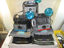 3 vintage Polaroid instant pack film cameras, 104,210, 230, w/ 268 flash & inst.