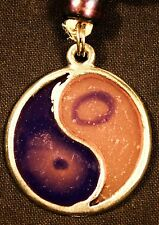 Psychedelic Yin/Yang symbol pendant on cord