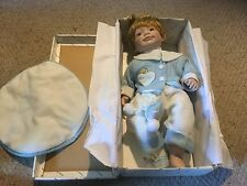 "Pre Owned DUCK HOUSE HEIRLOOM DOLLS PORCELAIN BABY DOLL 21"". Red hair, blue eyes"