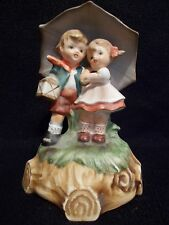 Lefton ceramic Boy/Girl under Umbrella Music Box Figurine plays Love Story theme